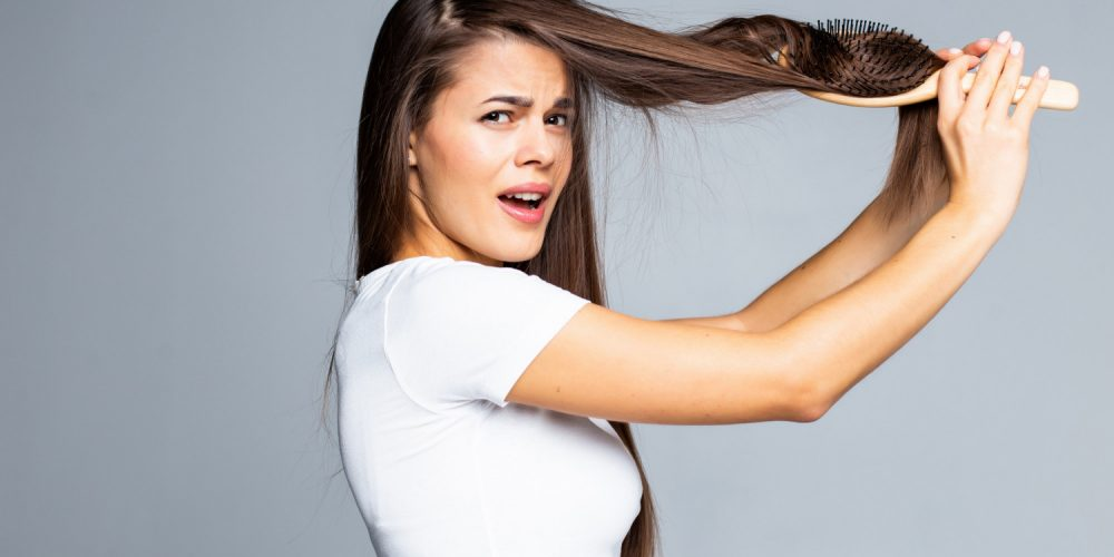 Young Woman Problems With Hair Split Weak Hair Tangled Hair Isolated Gray