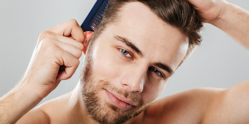 Close Up Portrait Smiling Man Combing His Hair
